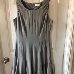 Fitted and fully lined gray work dress.